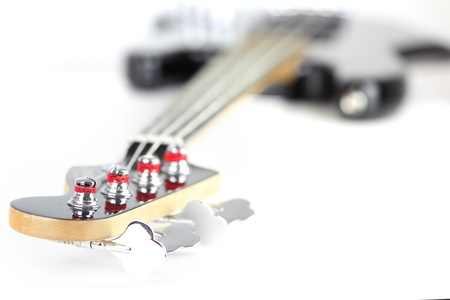 bass guitar: Electric Bass Guitar isolated on white background Stock Photo