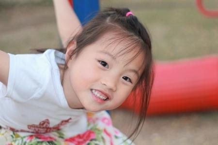 smile happy little asian girl photo