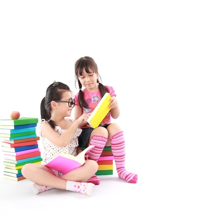 student little asian girl reading the book Stock Photo - 14408101