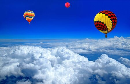 Hot air balloon on the cloud photo
