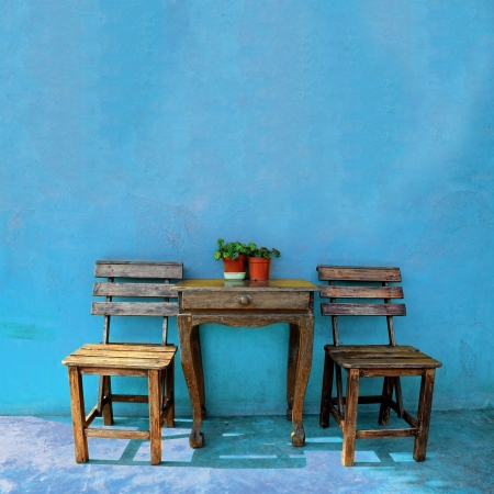 dining table and chairs: old vintage wooden chair and table Stock Photo