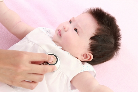 asian hospital: Doctor exams baby with stethoscope