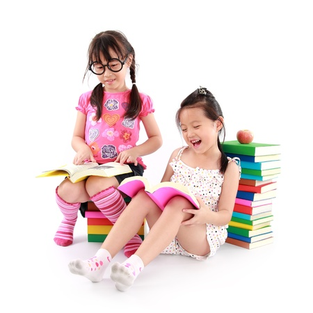 happy student little girl reading the book Stock Photo - 15038355