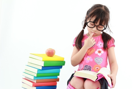 happy student little girl reading the book Stock Photo - 15038366