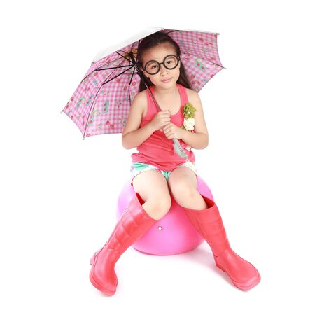 smiling little girl with umbrella and boots on white background photo
