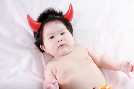 Adorable newborn baby with devil horn photo