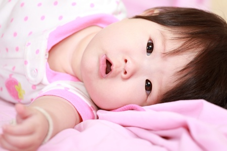 baby girl in the bed Stock Photo - 17486784