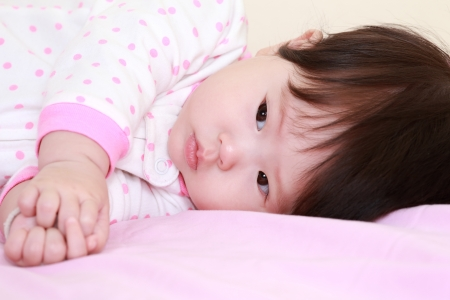 baby girl on the bed photo