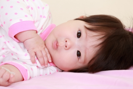 baby girl on the bed Stock Photo - 17486955