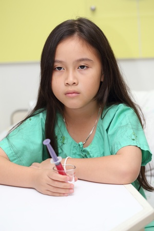 child in bed: Sick asian little girl in hospital