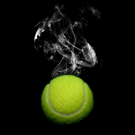 Tennis with smoke on black background photo