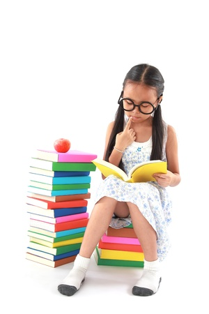student little asian girl reading the book photo