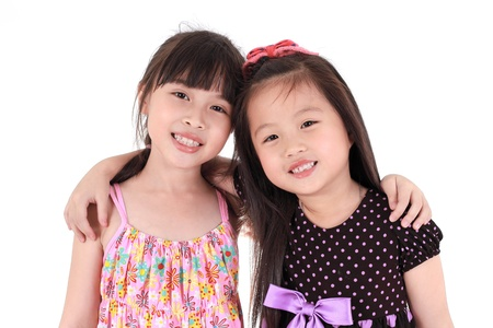 two beautiful little girls on a white background  Stok Fotoğraf