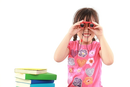 student little asian girl with binoculars photo