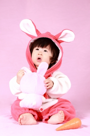 baby dressed in Easter bunny ears with carrot Stock Photo - 18309948