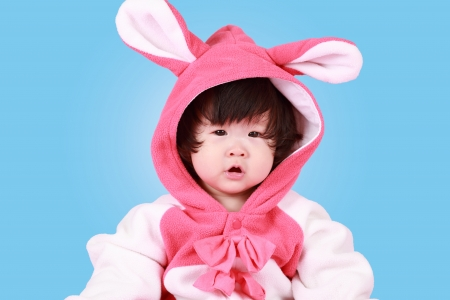 baby dressed in Easter bunny ears with carrot photo