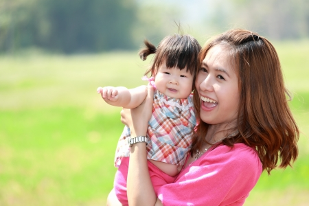 asian baby: Mother and daughter in the park Stock Photo