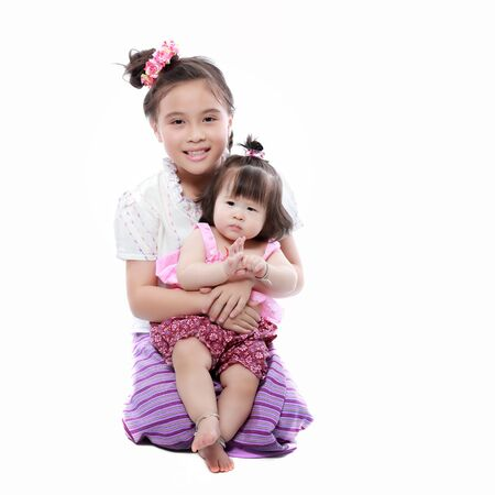 baby and littile girl dressing with thai traditional style photo