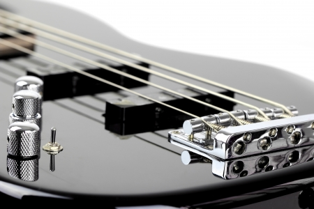 hardrock: Electric Bass Guitar isolated on white background Stock Photo