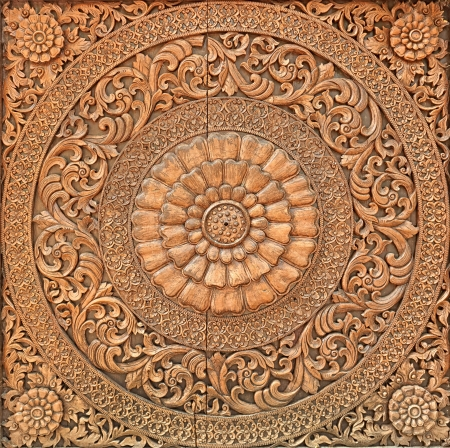 Pattern of flower carved on wood background Stock Photo - 21410812