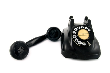 old telephone with rotary dial isolated on white background Stock Photo - 21771821