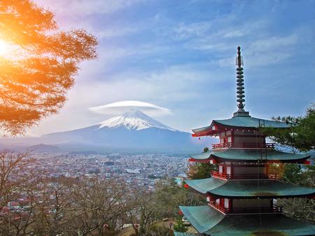 seaonal: Mt  Fuji viewed from behind Chureito Pagoda with cap cloud          Stock Photo