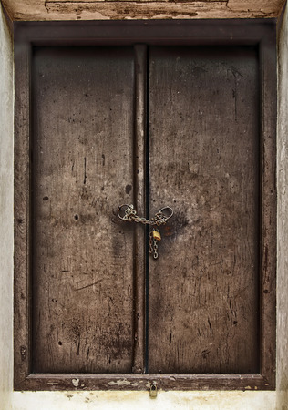 Old wooden door with Chain key lock photo