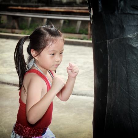 Thai boxing girl Stock Photo - 23174440