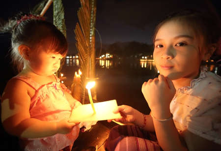 thai believe: Little girl in Loy Kratong festival, chiang mai thailand Stock Photo