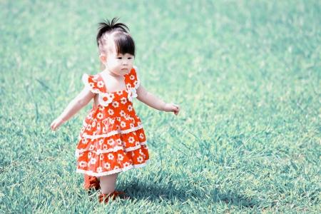 little girl on green grass lomo style