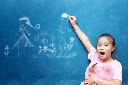 girl drawing my family on chalkboard Stock Photo - 26160083