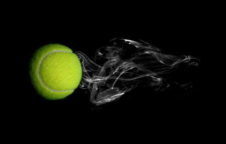 Tennis with smoke on black background photo