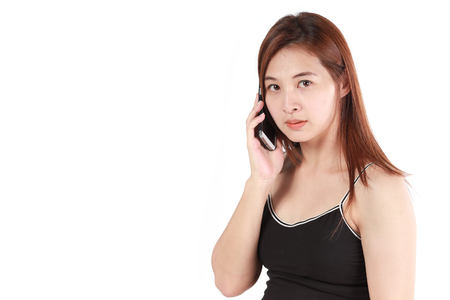 Beautiful Asian woman using phone isolated white background photo