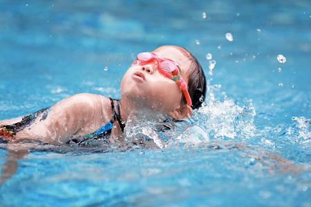 child swimming in the pool Banco de Imagens