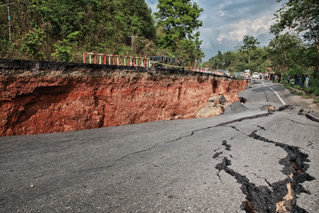rough road: Crack of asphalt road after earthquake Stock Photo