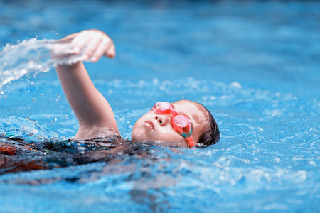 splash pool: children girl in swimming pool Stock Photo