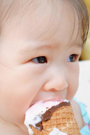 Little girl eating ice cream photo