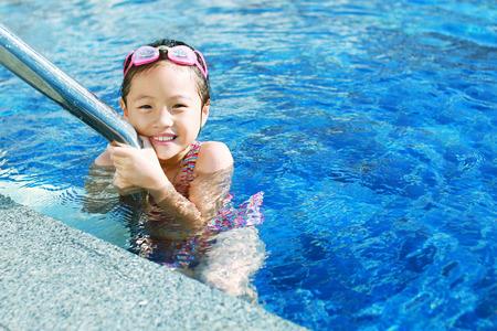 children in swimming pool photo