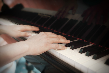 Close up of musician playing a piano photo