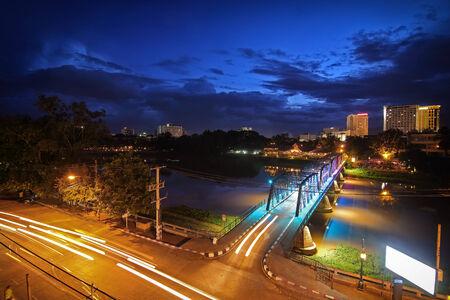 Night View of iron Bridge in Chiang mai Thailand photo