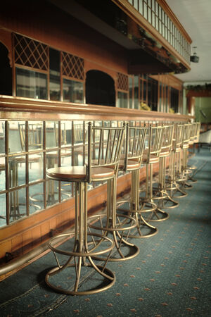 old bar: Vintage Counter and barstools  Stock Photo