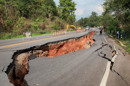 Crack of asphalt road after earthquake Redactioneel