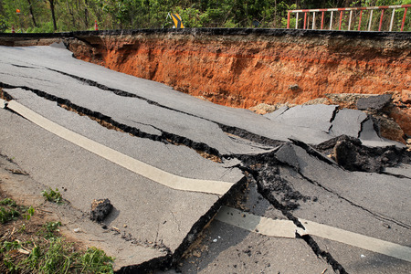 earthquake: Crack of asphalt road after earthquake Stock Photo