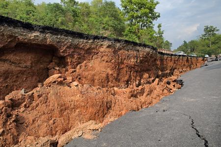 red soil: Crack of asphalt road after earthquake Stock Photo