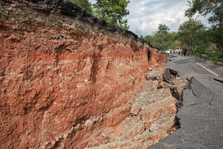 rock layers: Crack of asphalt road after earthquake Editorial