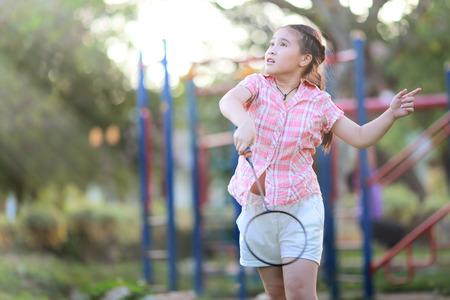 Cute little girl playing badminton photo