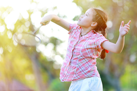 Cute little girl playing badminton Stock Photo