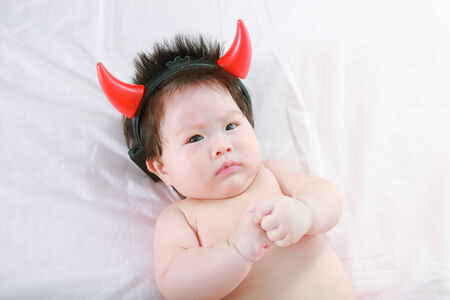 little baby funny with devil horns photo