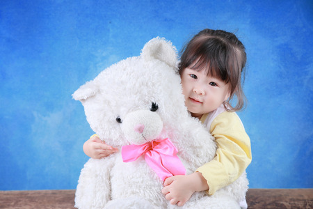 Portrait of little girl with teddy bear