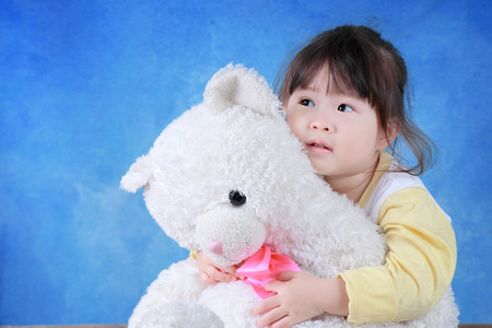 stuffed animals: Portrait of little girl with teddy bear